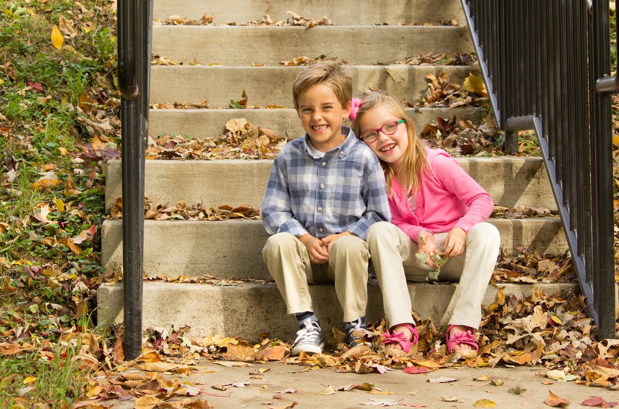 family photo, brother and sister on stairs