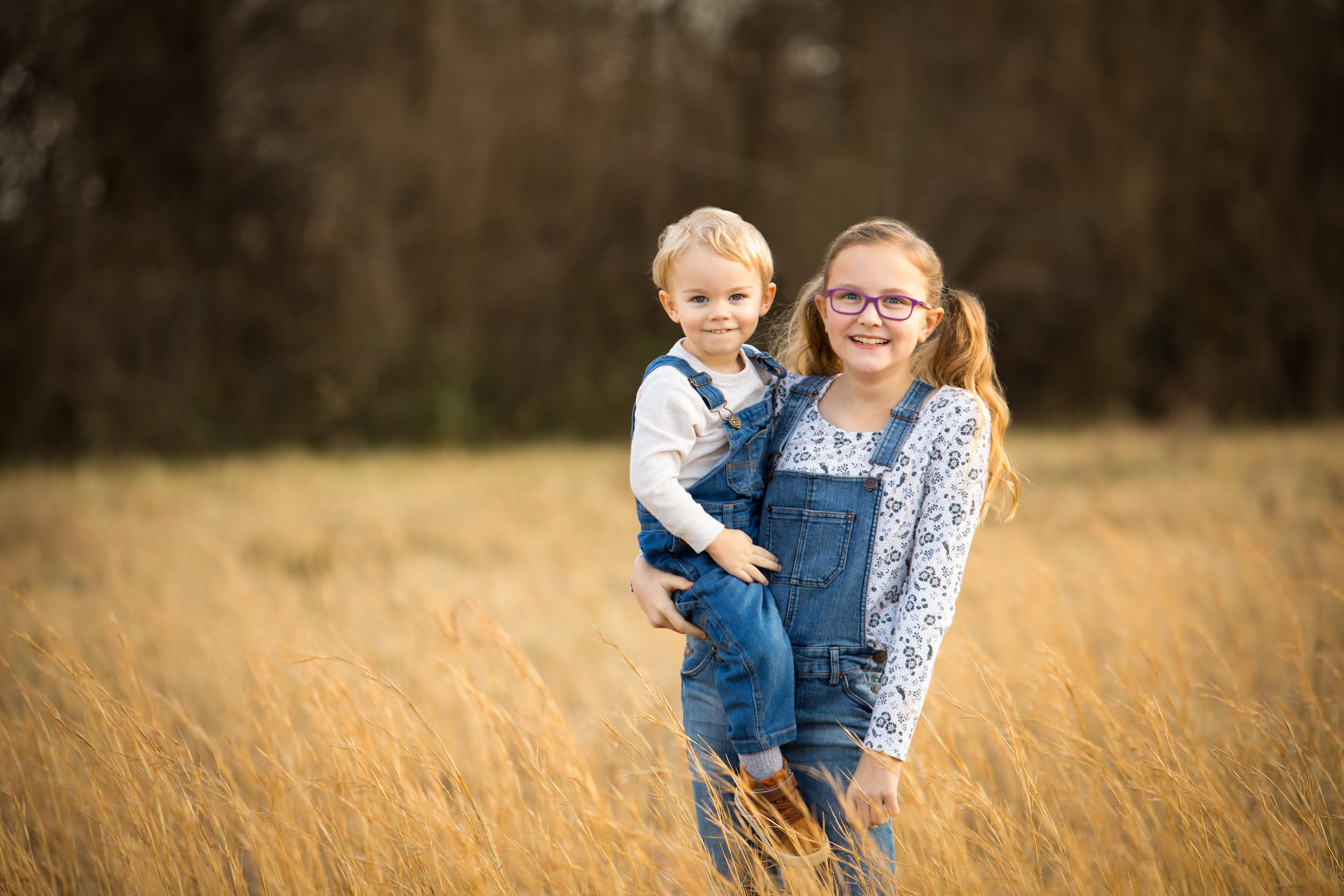sibling photo in field