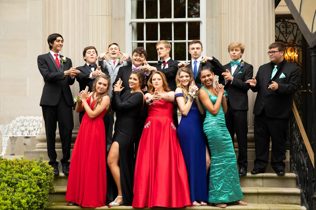 group photo of high school prom goers