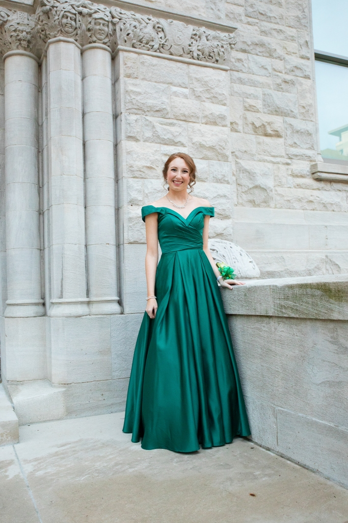 girl in green prom dress outside of old courthouse building in Lexington, KY